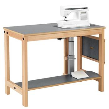 Sewing machine table with electric lift